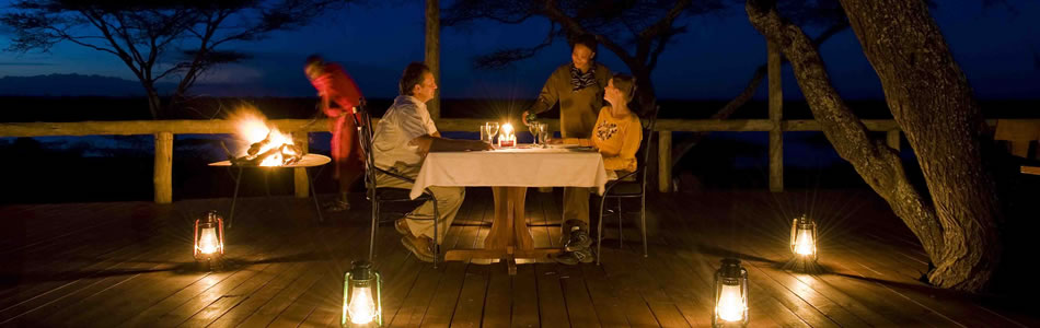 Dinner on the verandah at Lake Masek luxury tented safari camp